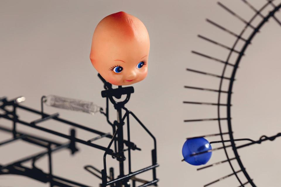 "Arthur Ganson's kinetic sculpture ""Child Watching Ball."""